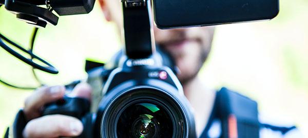 Man holding a DSLR camera