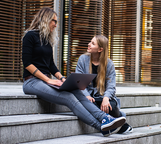 A female student mentoring a younger student
