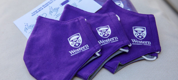 Purple Western-branded face masks together on a table.